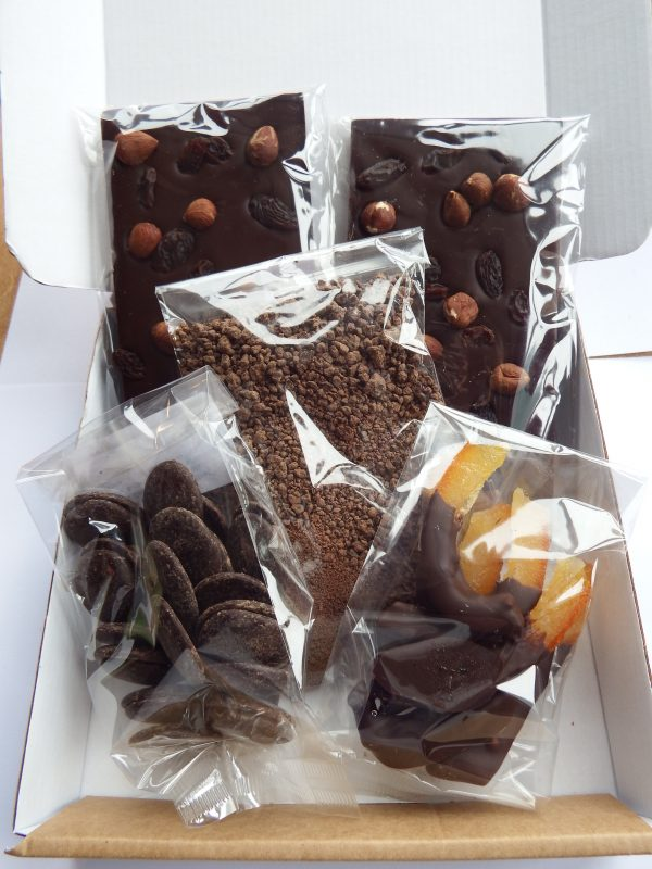 chocolate fruit and nut bars with hot chocolate, chocolate buttons and dipped candied orange peel