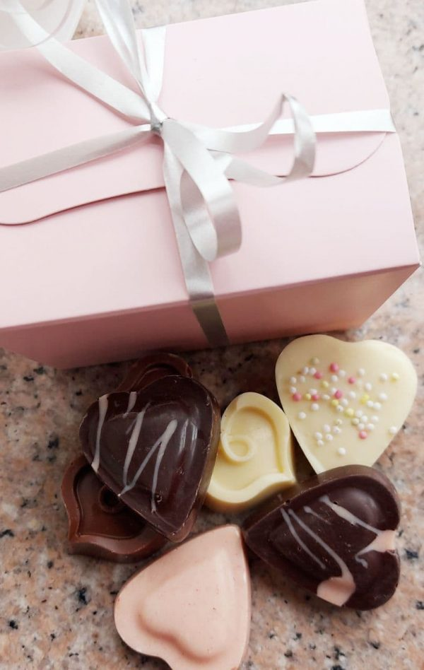 Pastel pink ballotin of assorted chocolate hearts